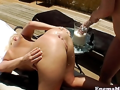 Milksquirting dykes analplay with dildo
