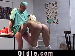 Busty vixen strips for old man and sucks his flabby dick